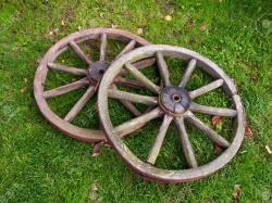 10038137-Two-old-broken-wheel-from-vintage-cart-Stock-Photo-farm-old-wheels